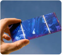 hand holding solar cell